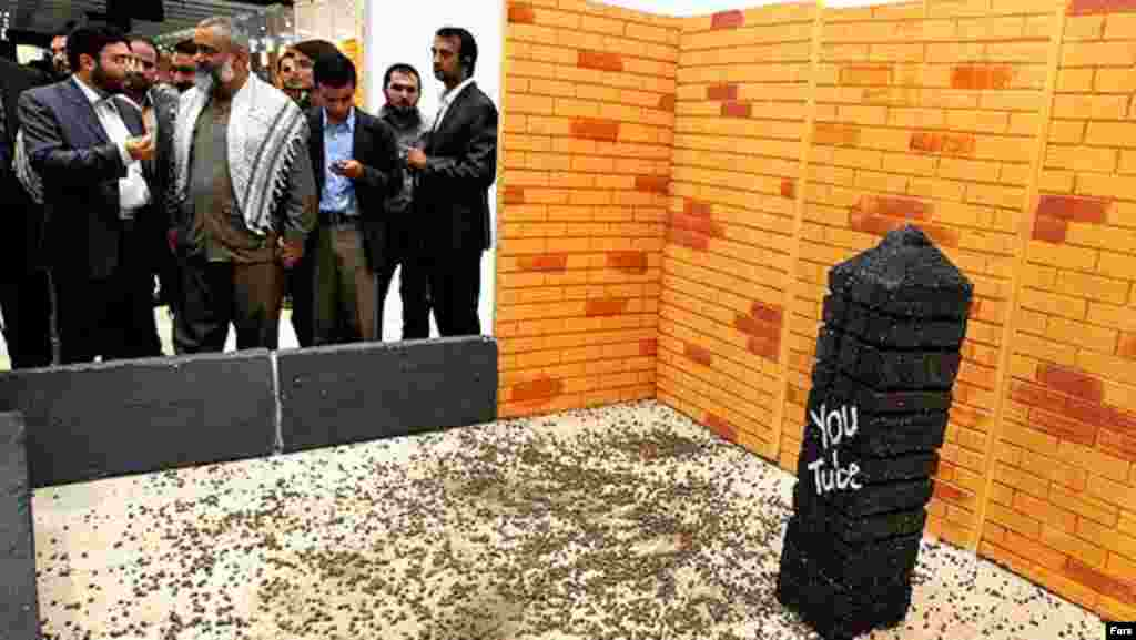A symbolic stoning of YouTube takes place at the Digital Media Exhibition in Tehran in November 2011. (Fars)