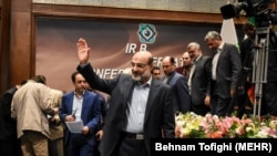Head of Iran's state-run TV IRIB, Abdulali Ali-Asgari (C), alongside other Iranian officials in the opening ceremony of Iran-Kala channel, on March 04, 2018.