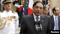 Pakistan's President Asif Ali Zardari speaks to journalists after a meeting with France's President Nicolas Sarkozy in Paris.