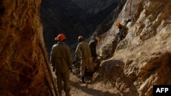 Afghan miners work at a gold mine on a mountainside near the village of Qara Zaghan in Baghlan Province.