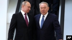 Russia - Russian President Vladimir Putin, left, and Kazakhstan's President Nursultan Nazarbayev speak during a Supreme Eurasian Economic Council meeting in Sochi, Russia, May 14, 2018.