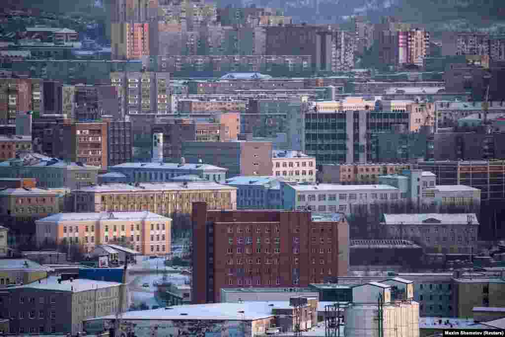 Across the border, around Russia's port town of Murmansk (pictured), Russia's forces have also reportedly carried out maneuvers in recent weeks.