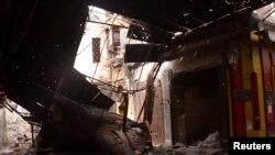 Алеппо шәһәрендә Сүрия президенты Бәшәр Әсад көчләре һөҗүмендә җимерелгән бина. 25 февраль 2012