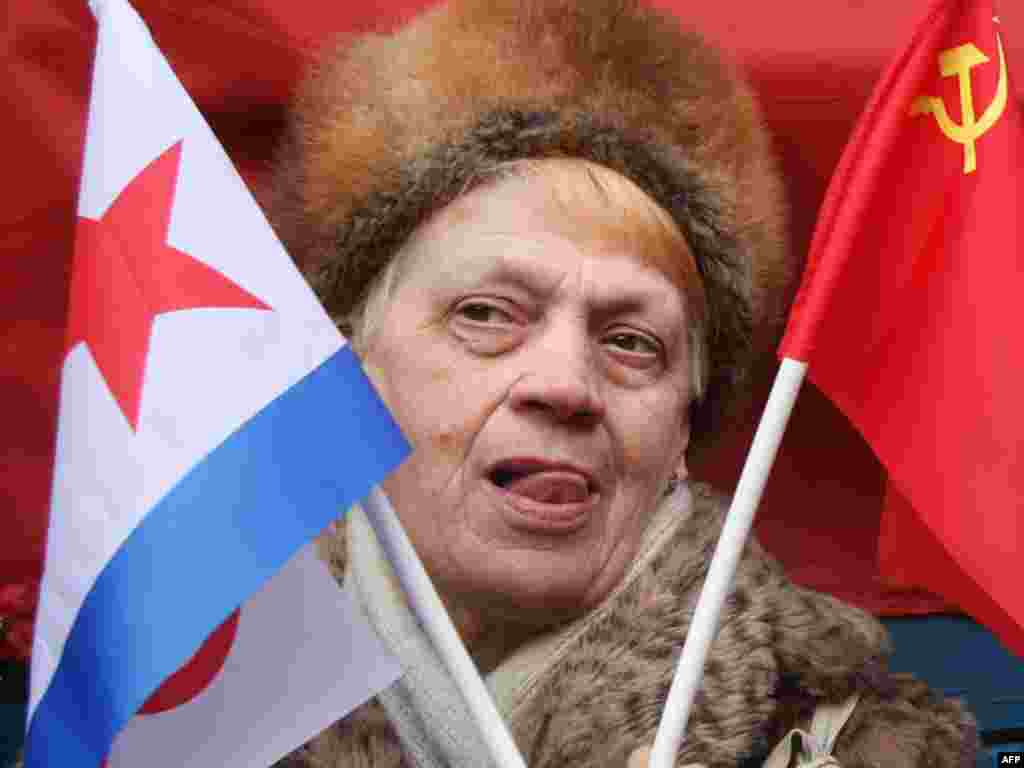 A supporter of the Communist Party attends a rally in Moscow. - On February 23, Russia's Communist Party marked Defenders of the Fatherland Day, formerly Red Army Day during the Soviet era. Photo by Andrei Smirnov for AFP