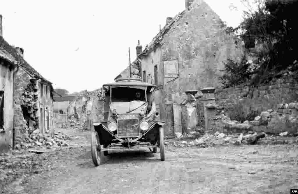 An American Ford ambulance is parked in a devasted village in Belgium in September 1918.
