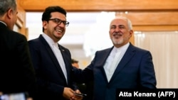 IRAN -- Iranian Foreign Minister Mohammad Javad Zarif (R) speaks with ministry spokesman Abbas Mousavi in the capital Tehran, June 10, 2019