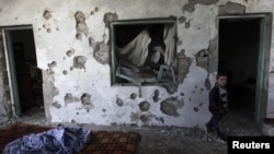 Оштетена куќа во Сирија по нападите на владините сили