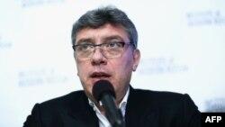 Оппозиционный политик Борис Немцов был убит в центре Москвы четырьмя выстрелами в спину.