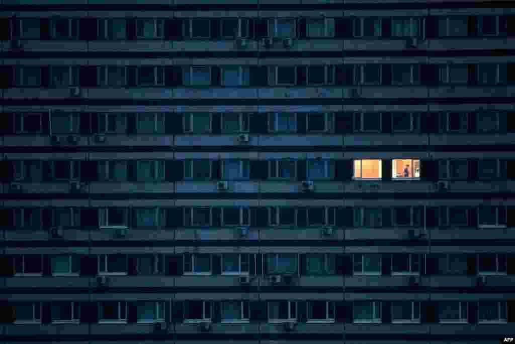 A man stands in his apartment in a building on the outskirts of Moscow during a strict coronavirus lockdown in the Russian capital on May 4. (AFP/Kirill Kudryavtsev)