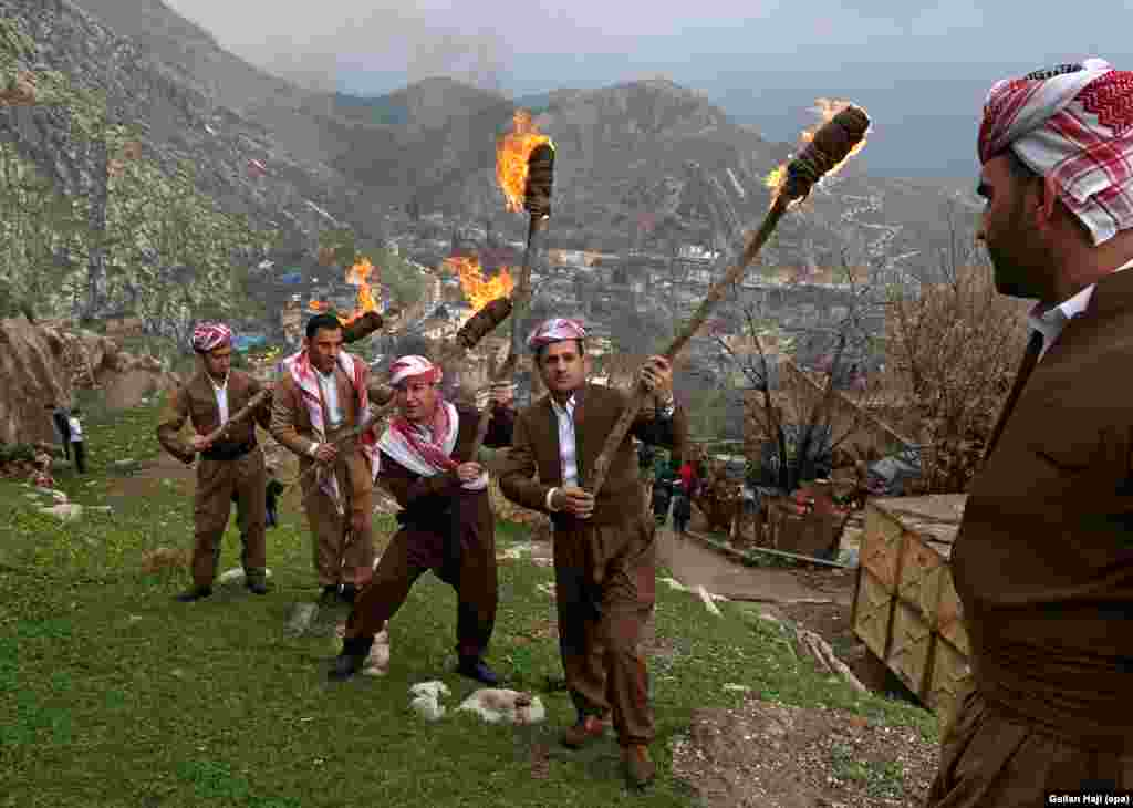 Iraqi Kurds mark Norouz with a torch-lit procession up a mountain above the town of Aqrah, some 100 kilometers east of Mosul.