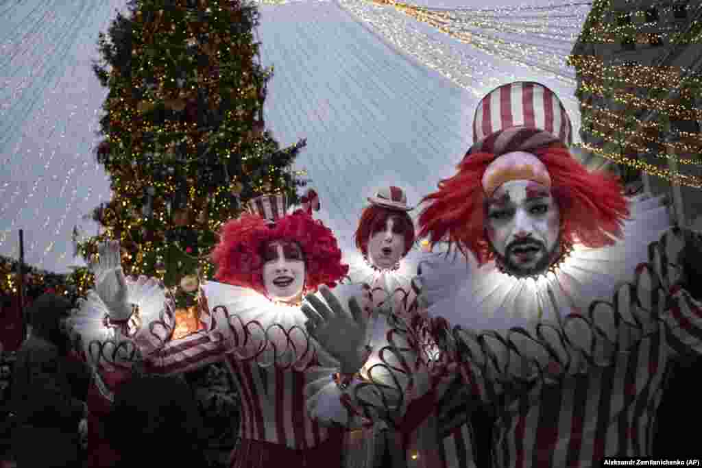 Clowns perform near a seasonally decorated Red Square in Moscow. (AP/Alexander Zemlianichenko)