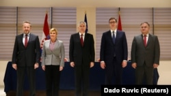 Bosnian presidency Chairman Dragan Covic (center) and members Bakir Izetbegovic (left) and Mladen Ivanic (right) pose for a photo with Croatian President Kolinda Grabar Kitarovic (2nd left) and Serbian President Aleksandar Vucic (2nd right) after talks in Mostar on March 6.