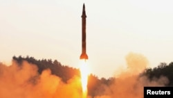 A North Korean ballistic missile is test-fired in an image released in May.