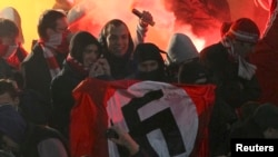 Fans demonstrate as they hold up a Nazi flag in the stands of the Spartak Moscow supporters during the Russian Cup match between Shinnik Yaroslavl and Spartak Moscow in Yaroslavl on October 30.