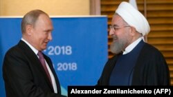 د ایران ولسمشر حسن روحاني له خپل روسي سیال سره. پخوانی عکس