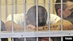 Татуировка на руке подсудимого. Свердловск, Россия, 2010