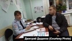Василий Каверин в отделении полиции Кемерова 24 февраля 2018 года