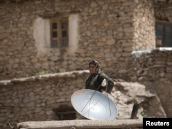 A satellite dish on a rooftop in Iran's Kurdistan Province