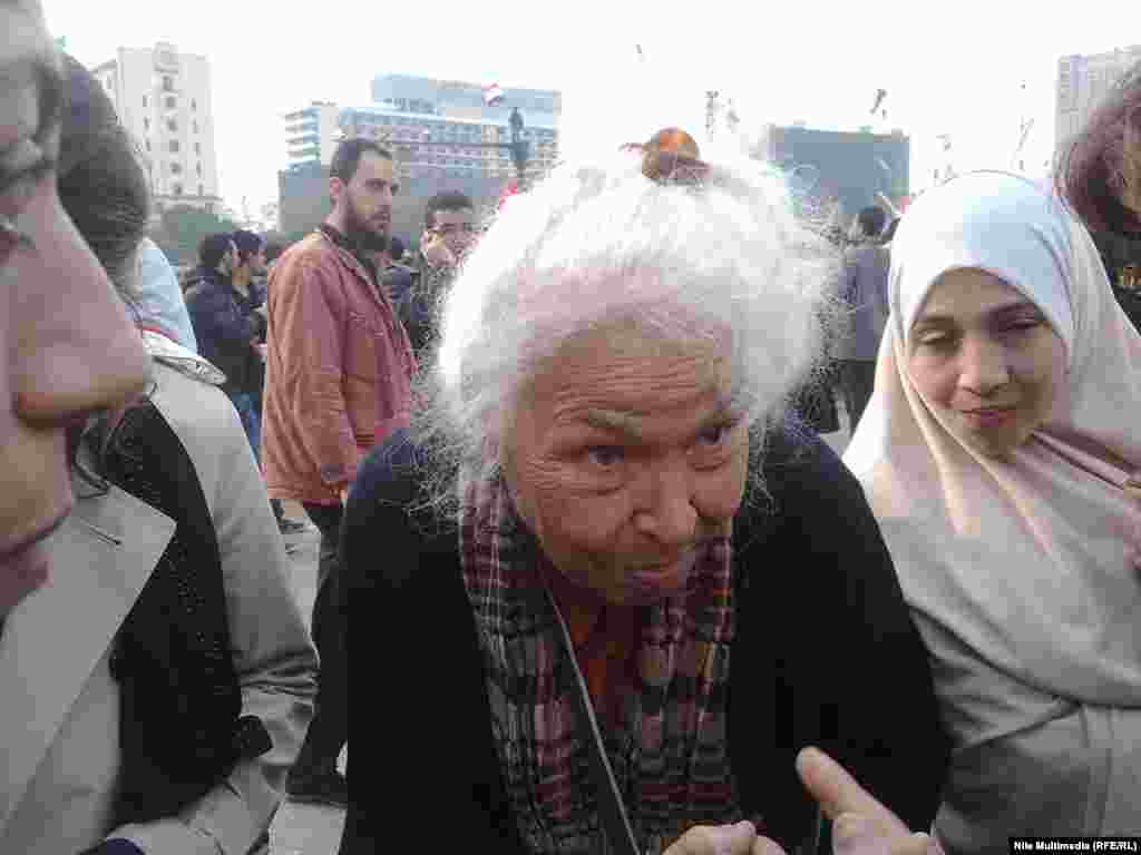 Nawal al-Sa'adawi, a well-known Egyptian feminist and writer, walks around the square and meets with some of the protesters.
