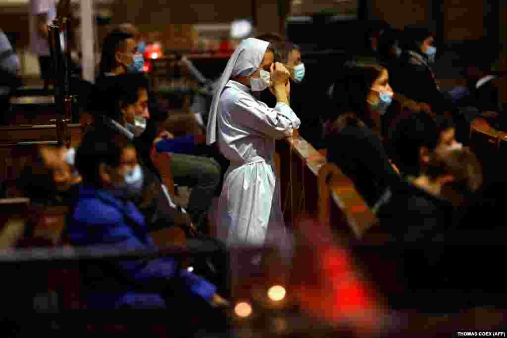 A nun prays at the Sacre-Coeur Basilica in Paris.