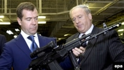 Russian President Dmitry Medvedev inspects a Kalashnikov rifle during a visit to a plant in Izhevsk in 2008.