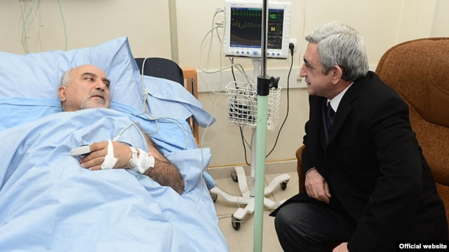 Armenian President Serzh Sarkisian visits wounded opposition presidential candidate Paruyr Hairikian at a Yerevan hospital.