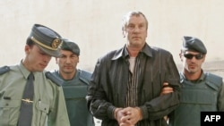 Gennady Petrov is escorted to court in Palma de Mallorca in June 2008.