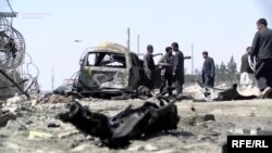 The site of a car-bomb attack claimed by the Taliban in Kabul