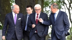French Foreign Minister Laurent Fabius (left), Ukrainian Foreign Minister Pavlo Klimkin, German Foreign Minister Frank-Walter Steinmeier, and Russian Foreign Minister Sergei Lavrov attend a meeting on Ukraine in Berlin in August 2014.