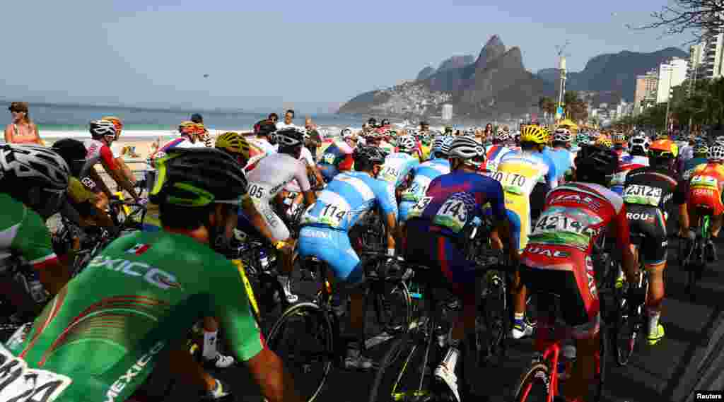 Cyclists start the men's road race race from Copacabana Beach.