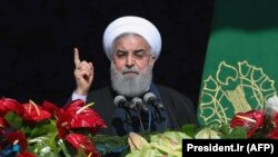 Iranian President Hassan Rohani delivers a speech during a rally marking the 39th anniversary of the 1979 Islamic Revolution in Tehran on February 11.