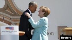 U.S. President Barack Obama (left) and German Chancellor Angela Merkel embrace after delivering remarks in the Bavarian village of Krun on June 7.