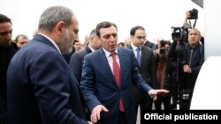 Armenia - Businessman Davit Ghazarian (C) shows Prime Minister Nikol Pashinian around a newly built dairy factory of his Spayka company, Yerevan, March 26, 2019.