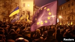 People attending a rally held by supporters of EU integration near the presidential administration building in Kyiv on December 3.