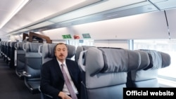 Azerbaijani President Ilham Aliyev tests out a new rail line connecting Baku and Sumgait.