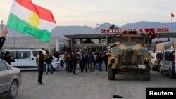 قوات البيشمركه الكردية تعبر تركيا الى كوباني السورية