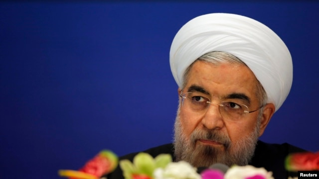 Iranian President Hassan Rohani arrives at a news conference in Shanghai on May 22.