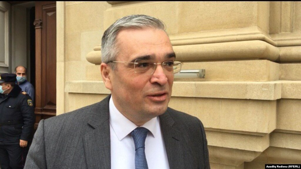 Ilqar Mammadov speaks to reporters on April 23 in Baku.