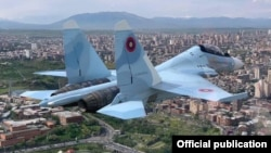 Armenia -- A Su-30SM fighter jet of the Armenian Air Force flies over Yerevan, May 4, 2020.