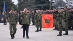 Kosovar President Hashim Thaci (second from left) inspects members of the Kosovo Security Force in Pristina on December 13.
