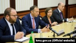 U.S. Assistant Secretary of State Francis Fannon (center) speaks during a meeting with the prime minister of Ukraine in July.