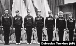 Coach Renald Knysh (left) poses with the Soviet women's gymnastics team in the Sports Palace in Minsk in 1977.