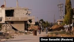 Разрушенные дома на одной из улиц в Дамаске, 23 июля 2017