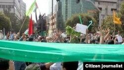 Иран оппозициясынын лидери Мир Хусейн Мусавинин тарапкерлери Кудус күнү болгон демонстрацияда.