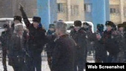 Police officers in downtown Zhanaozen on the day of the most deadly clashes, December 16.
