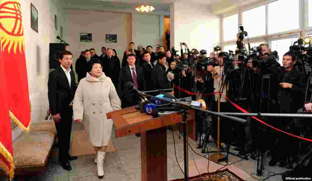 Outgoing leader Roza Otunbaeva arrives to vote at a Bishkek polling station.