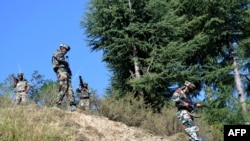 Indian army soldiers take positions at Hafruda forest in Kashmir's Kupwara district on October 5.
