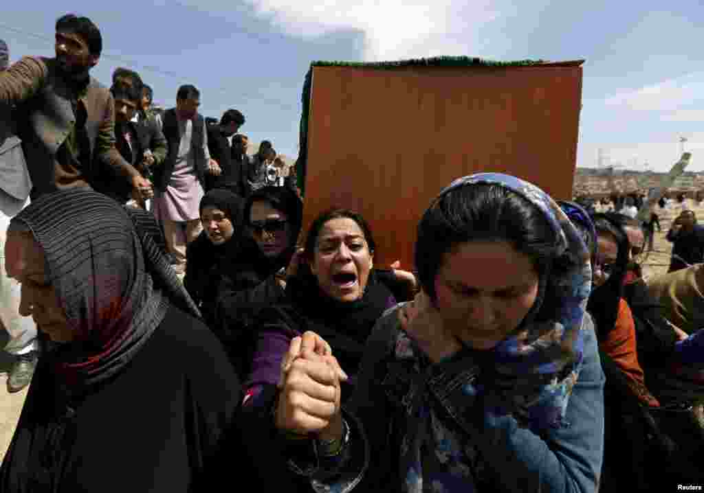 Afghan women's rights activists carry the coffin of Farkhunda, an Afghan woman beaten to death and set alight, during her burial ceremony in Kabul, on March 22, 2015. (Reuters/Mohammad Ismail)