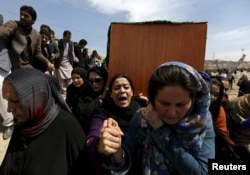 Women's rights activists carry the coffin of Farkhunda Malikzada, who was beaten to death by a mob in Kabul in 2015 after being falsely accused of burning a copy of the Koran.