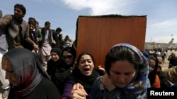 Afghan women's rights activists carry the coffin of Farkhunda during her burial ceremony in Kabul in March.